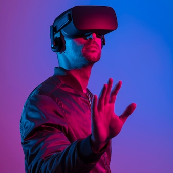 Man wearing vr glasses  with gradient background