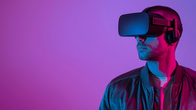 Man wearing vr glasses  with purple light