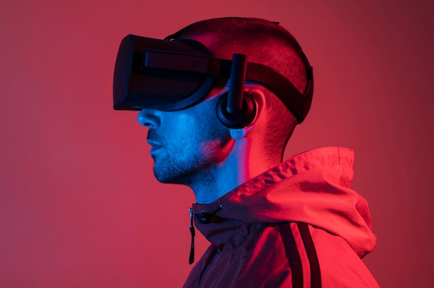 Man wearing vr glasses with red light