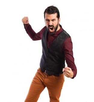 Man wearing waistcoat giving punch
