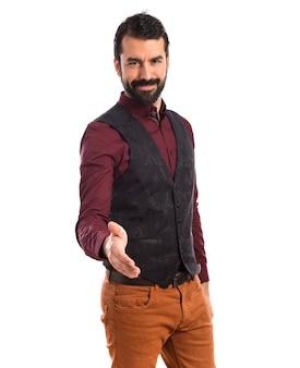 Man wearing waistcoat making a deal