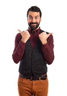 Man wearing waistcoat with thumb up