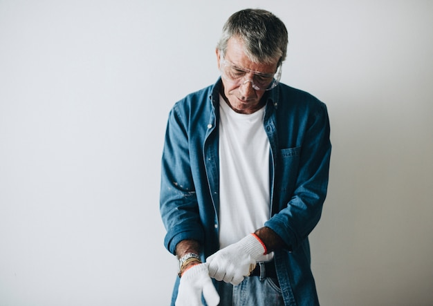 Man wearing white protective gloves