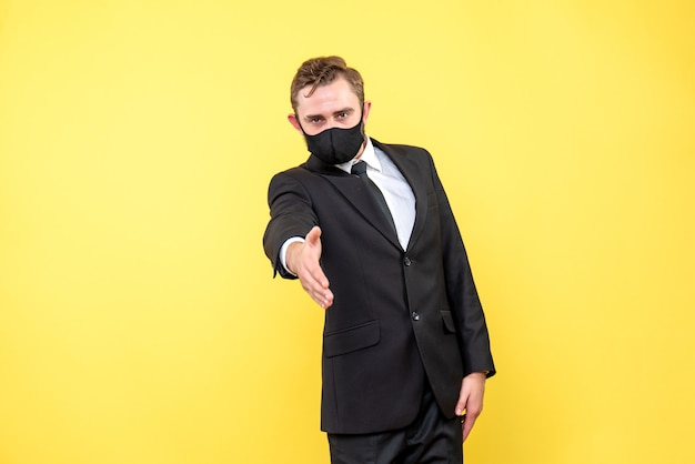 Man welcomes business partners on yellow