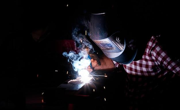 Man welding in an industrial workshop