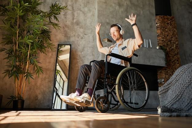 Man in wheelchair enjoying music