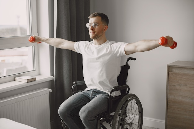 A man in a wheelchair is doing sports. never give up