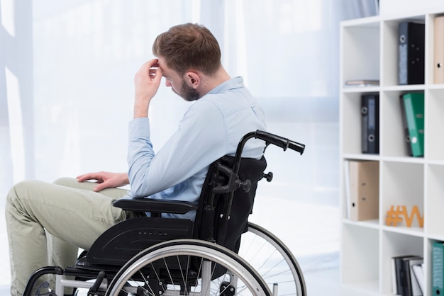 Man in wheelchair thinking