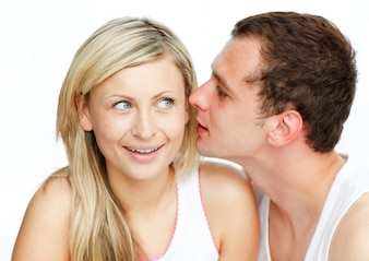 Man whispering a woman something important