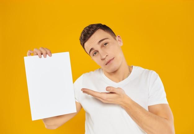 Man in white paper tshirt presentation copy space studio