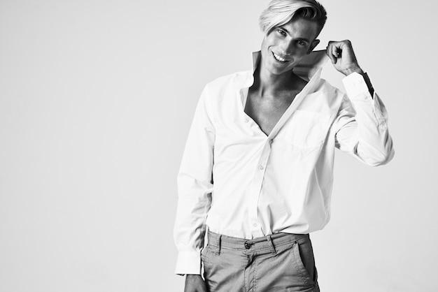 Man in white shirt holding collar elegant posing style