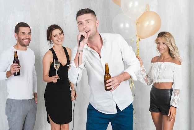 Man in white singing on party