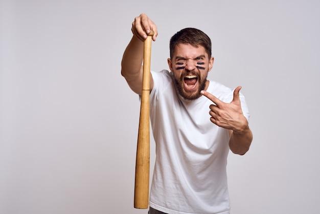 A man in a white t-shirt with baseball bat