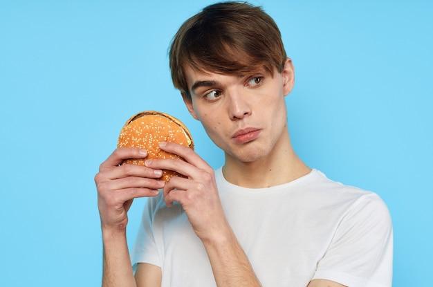 Man in white tshirt hamburger diet food snack lifestyle