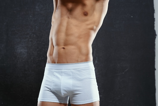 Man in white underpants pumped up body fitness exercise bodybuilding
