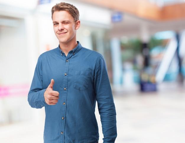 Man winking and thumb up
