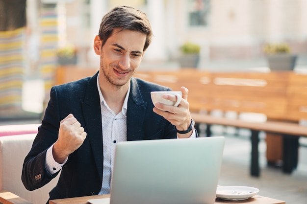 Man winner look with laptop