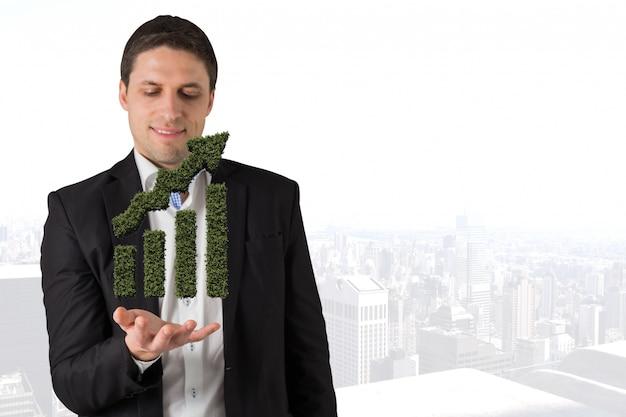 Человек с гистограмме траве в их руках