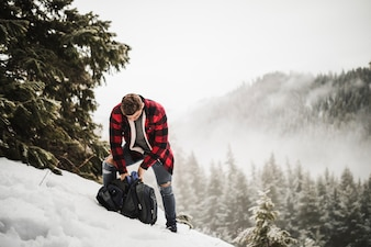 Man with backpack on snowy hill