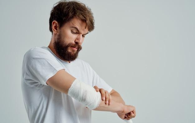 Man with bandaged arm injury health problem hospital