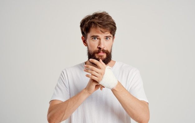Man with bandaged arm traumatology treatment health problems