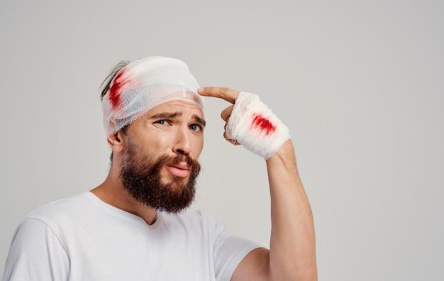 Man with bandaged head blood trauma hospitalization treatment