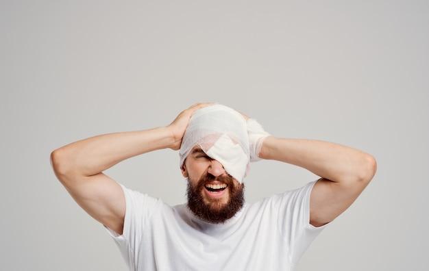 Man with bandaged head health problems pain hospitalization trauma center