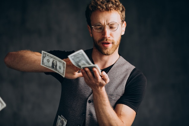 Man with banknotes isolated in studio
