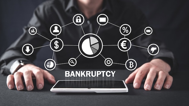 Man with a bankruptcy text and financial network.