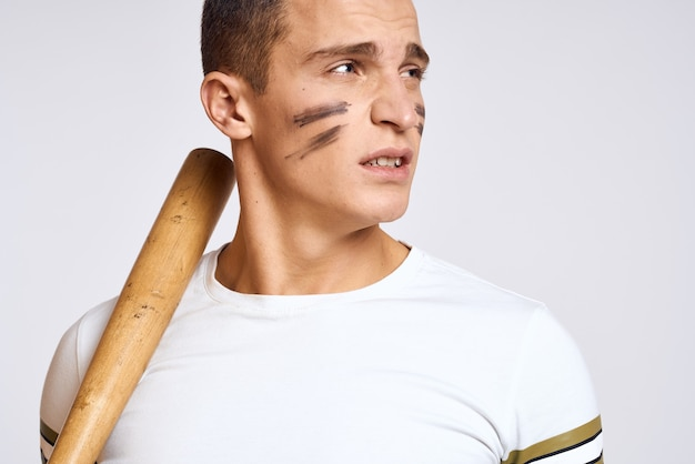 Man with a baseball bat in hand