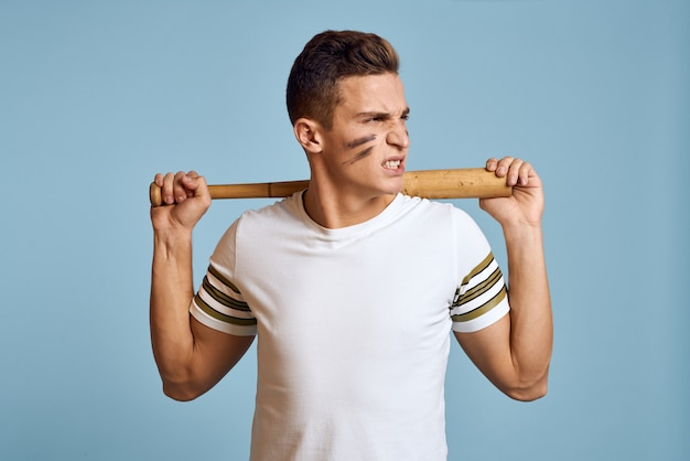 Man with baseball bat in hands