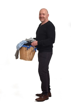 A man with a basket of dirty clothes on white background