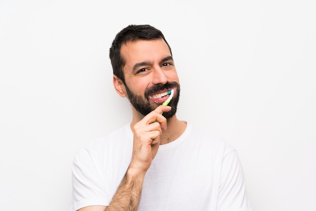 Man with beard brushing teeth
