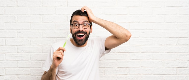 Man with beard brushing teeth