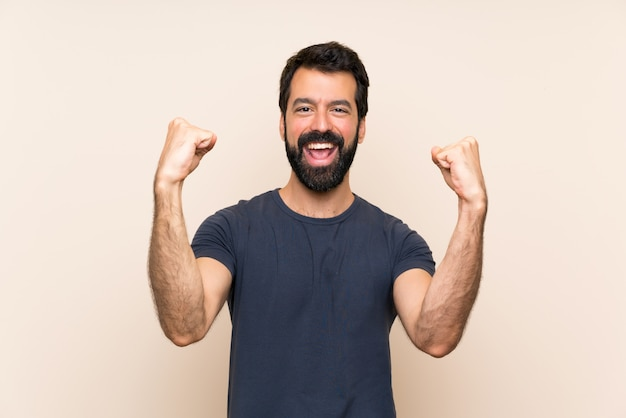 Man with beard celebrating a victory