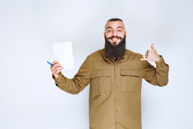 Man with beard checking the project list and looks satisfied.