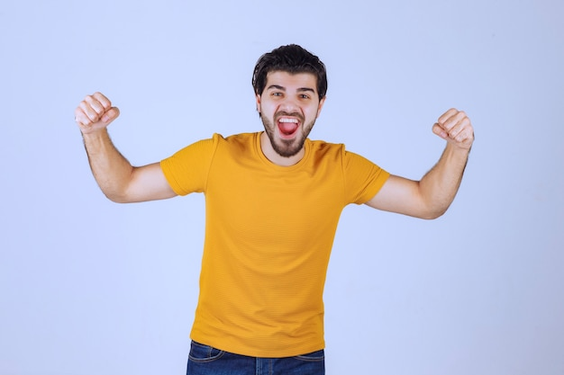 Man with beard demonstrating his fist and arm muscles and feeling powerful