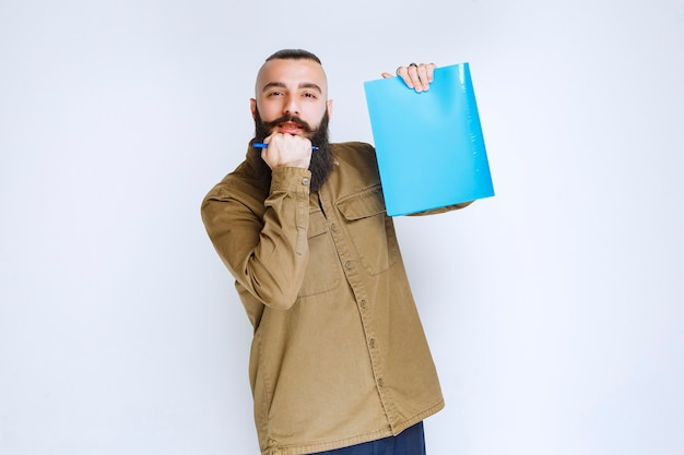 Man with beard demonstrating his project and waiting for reviews.
