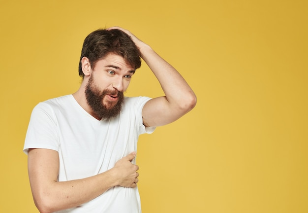 A man with a beard gestures with his hands side view copy space