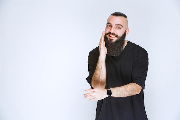 Man with beard giving flirtatious poses.
