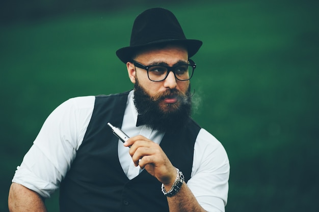 Man with a beard and glasses in the green field