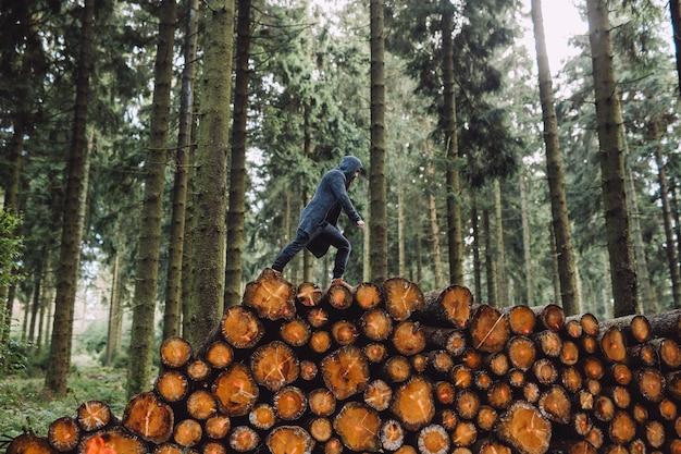 Man with a beard goes on wood in the forest