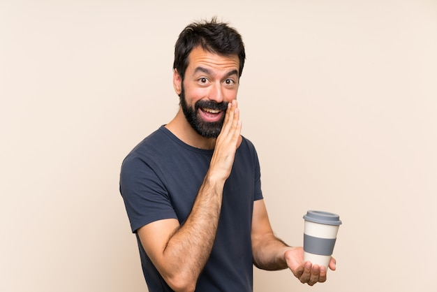 Man with beard holding a coffee whispering something