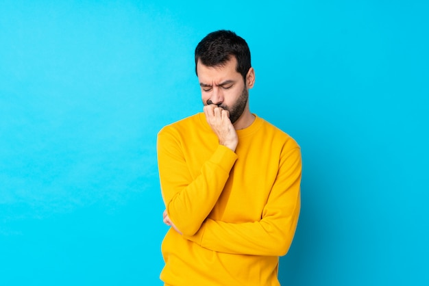 Man with beard over isolated blue wall