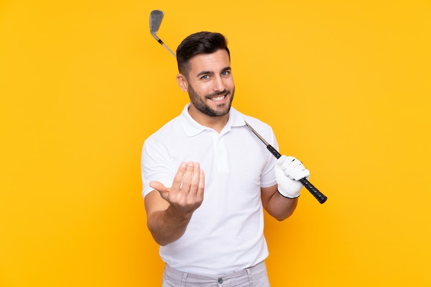 Man with beard playing golf over isolated wall