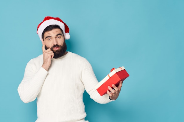 Man with a beard posing in the studio christmas