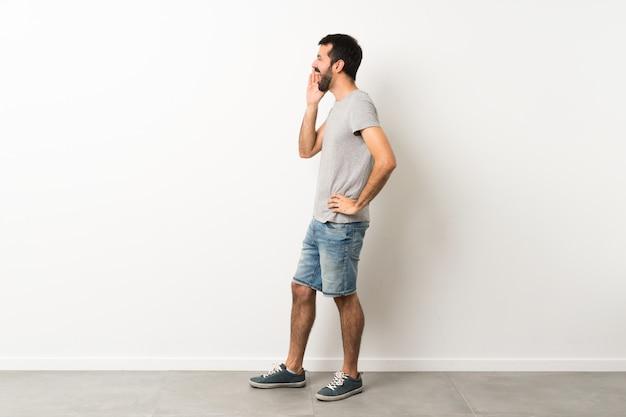 Man with beard shouting