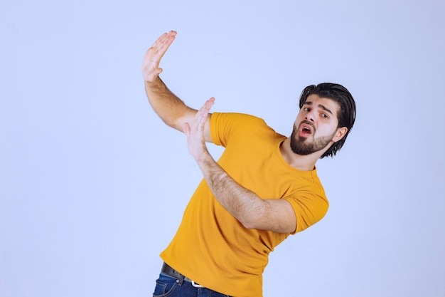 Man with beard stopping something