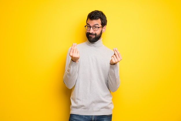 Man with beard and turtleneck making money gesture