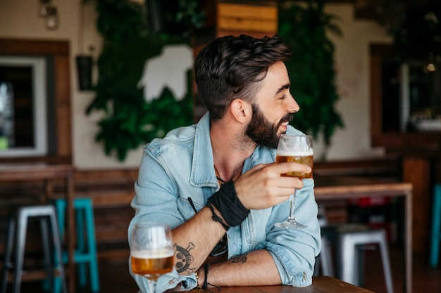 Man with beer looking to his left